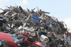 Scrap Dump. Heap of scrap metal and household objects at a recycling facility Stock Photos