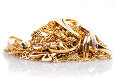 Scrap Gold. Pile of Gold Jewelry on a white background Stock Images
