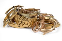 A scrap of gold. Old and broken jewellery royalty free stock photography