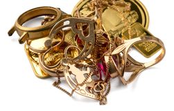 A scrap of gold. Old and broken jewelry, watches of gold and gold-plated stock images