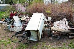 Scrap-heap. Rural garbage heap of broken metal things stock image