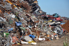 Scrap heap. Scrap Metal ready for recycling with blue sky Stock Image