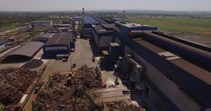Scrap heap. Scrap, scrap heap, unloading of scrap metal factory, view from above, cover shot, metallurgical plant stock video