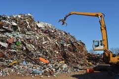 Scrap iron. Crane grabber snatch recycling metal at a scrap-iron junk Stock Photo