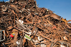Scrap and junk pile. Scrap metal, plastic and blue sky Stock Image