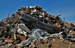 Scrap and junk pile. Scrap metal, plastic and blue sky Royalty Free Stock Photography