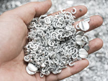 Scrap metal aluminum in hand Royalty Free Stock Photography