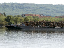 Scrap metal barge on Danube river royalty free stock photography