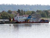 Scrap metal barge on Danube river Stock Image