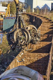 Scrap metal being loaded onto a train Stock Images