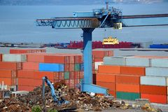 Scrap metal and cargo container Royalty Free Stock Photos