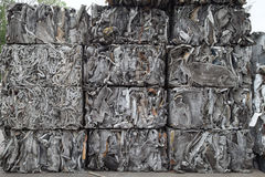 Scrap metal cubes. Piles of scap metal bundled in cubes for recycling Stock Images