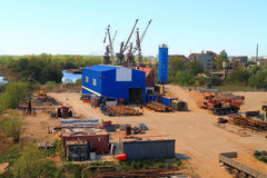 Scrap metal dealer in an industrial zone on the river bank Pregolya in Kaliningrad Royalty Free Stock Images