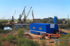 Scrap metal dealer in an industrial zone on the river bank Pregolya in Kaliningrad Stock Image