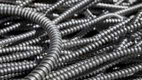 Scrap metal electrical conduit for recycling Stock Photo