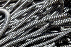 Scrap metal electrical flex conduit for recycling Stock Photography