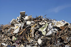 Scrap metal garbage waste dump. With blue sky background Stock Photo