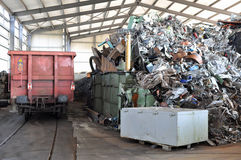 Scrap metal with goods waggon Royalty Free Stock Photo