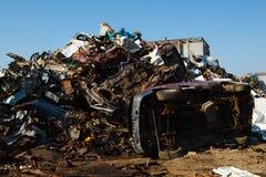 Scrap metal heap outdoors Stock Images