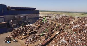 Scrap-metal. Metal loaded into wagons by crane, view from above, cover shot stock video