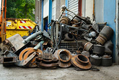 Scrap metal, old car parts. In a garage Stock Images