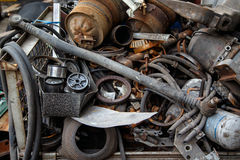 Scrap metal, old car parts. In a garage,close up Royalty Free Stock Images