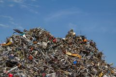 Scrap metal on a pile at a recycling junkyard. Stock Photo