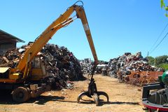 Scrap metal scrap-iron junk. Outdoor with crane Stock Photography