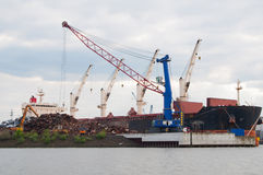 Scrap metal transporter ship. Transporter ship waiting for the crane to load the scrap metal Royalty Free Stock Photography