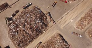 Scrap metal, view from above. Unloading of scrap metal factory, view from above, cover shot, the camera moves from top to bottom stock video footage