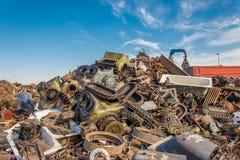 Scrap metals. Scrap metal and wonderful blue sky Stock Image