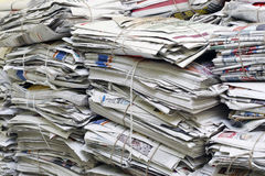 Scrap newspapers. Over issued newspapers arranged in piles for recycling Royalty Free Stock Images