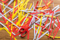 Scrap paper is cut with scissors on the table wooden Stock Photography