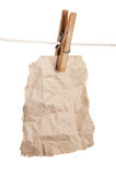 Scrap of paper on a wooden clothespins Stock Photo