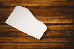 Scrap of paper on wooden table Stock Image