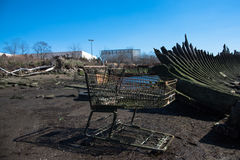Scrap of shopping cart in a cemetery of boats in Coney Island stock photo