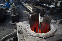 Scrap steel melts down in an induction furnace at a small foundr. Y Stock Image