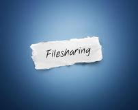 Scrap of torn paper with the word - Filesharing royalty free stock photography
