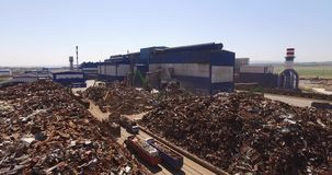 Scrap unloading. Unloading of scrap metal factory, view from above, cover shot stock footage