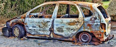 Absolutely burnt-out wreck of a car royalty free stock photos