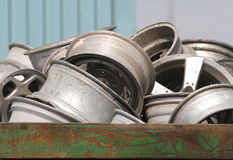 Scrap Wheels. Metal bin full of alloy wheels for recycling Stock Photo
