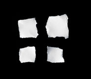 Scrap of white paper on black background Royalty Free Stock Images