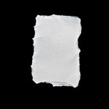 Scrap of white paper on black background Stock Photo