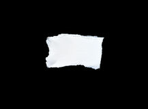 Scrap of white paper on black background Royalty Free Stock Image