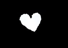 Scrap of white paper in heart shape Stock Photography