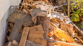 Scrap wood and lumber cuttings for firewood or junk removal service, in a pile. Useful for recycling projects or firewood, as