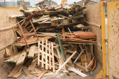 Scrap wood in a recycling skip. Royalty Free Stock Photo