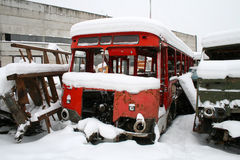 Scrap yard. Bus and truck covered with snow Royalty Free Stock Photos