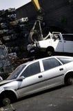 Scrap yard and crane Stock Image