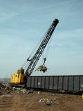 Scrap yard crane with magnet stock photo